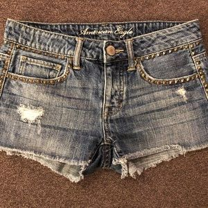 American Eagle studded and distressed jean shorts